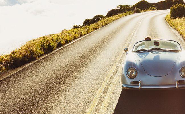 Porsche on road - hero